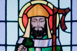 A stained glass depiction of Saint Patrick