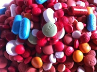 Close up view of a pile of assorted pills