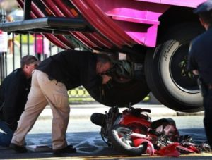 Police inspect a scooter crushed by a duck vehicle in Boston
