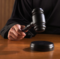 Concept image of a judge striking a desk with a gavel