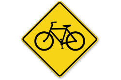 A bicycle crossing sign on a white background