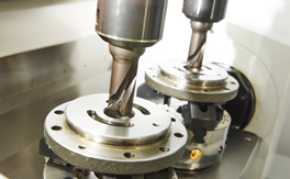 Close up view of two drills that are part of a drill press