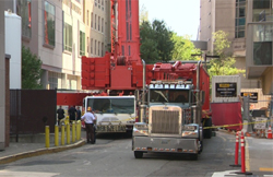 Emergency vehicles at the site of a crane accident in Boston's Longwood neighborhood