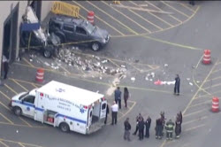 Aerial view of crashed SUV and ambulance with first responders at Billerica auto auction