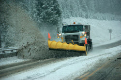 A snowlplow at work on a Massachusetts highway