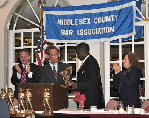 Boston personal injury attorney Doug Sheff accepts the Middlesex County Bar Association Outstanding Service Award