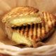 Closeup of a panini sandwich in a small wicker bowl