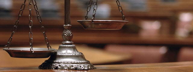 Close up view of scales, representing justice, in a courtroom
