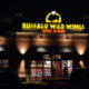 Night time exterior view of a Buffalo Wild Wings restaurant