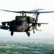 Daytime view of a Black Hawk helicopter in flight shot from another helicopter