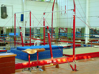 Gymnastics equipment set up in a gymnasium