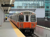 Daytime view of an MBTA Orange Line train at Assembly Station in Somerville