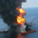 Fire burns at the site of a deep sea oil leak near a drilling platform