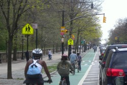 Cyclists ride in a bike lane near Boston Common