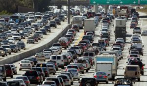 Daytime view of a highway congested with traffic