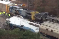 Daytime view of a derailed train car following an Amtrak crash in South Carolina